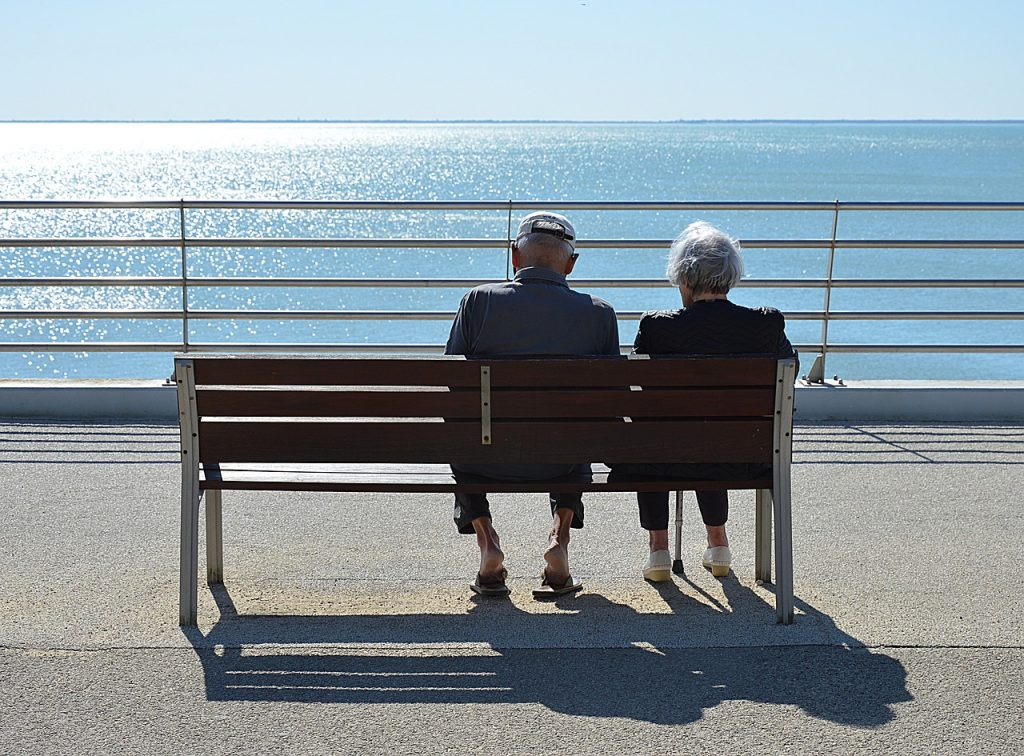 older couple sitting on bench