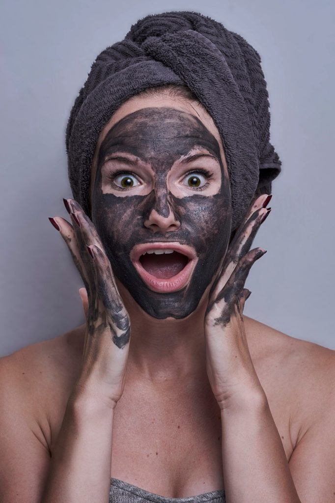 woman with face mask made from wood ashes