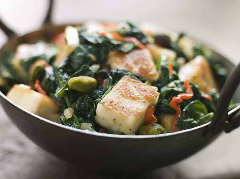 Close up image of Karai Dish with Spinach and fried Paneer