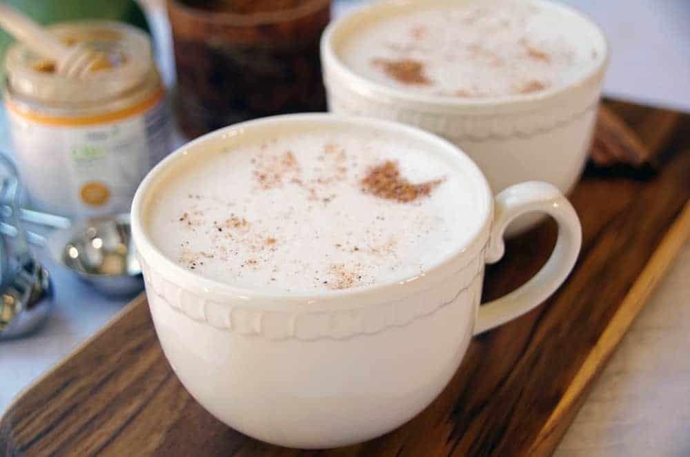 Mug of warm milk with cinnamon
