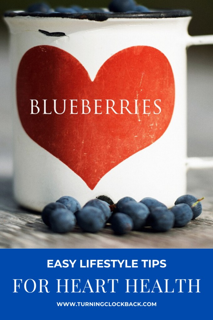 white cup of blueberries with red heart on it and text over lay Easy Lifestyle Tips For heart health