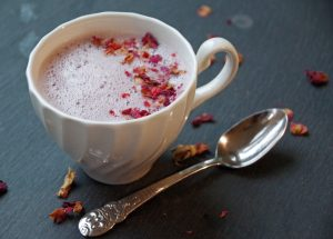 Tart Cherry Moon Milk in white mug with dried rose petals