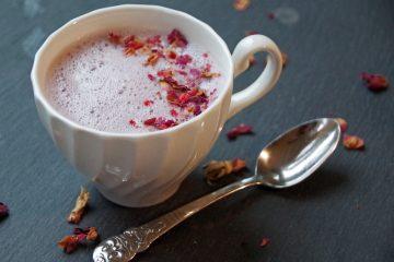 Tart Cherry Moon Milk in white mug with dried rose petals