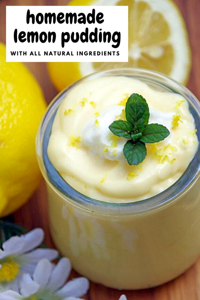 homemade lemon pudding in a glass jar with fresh lemons behind it