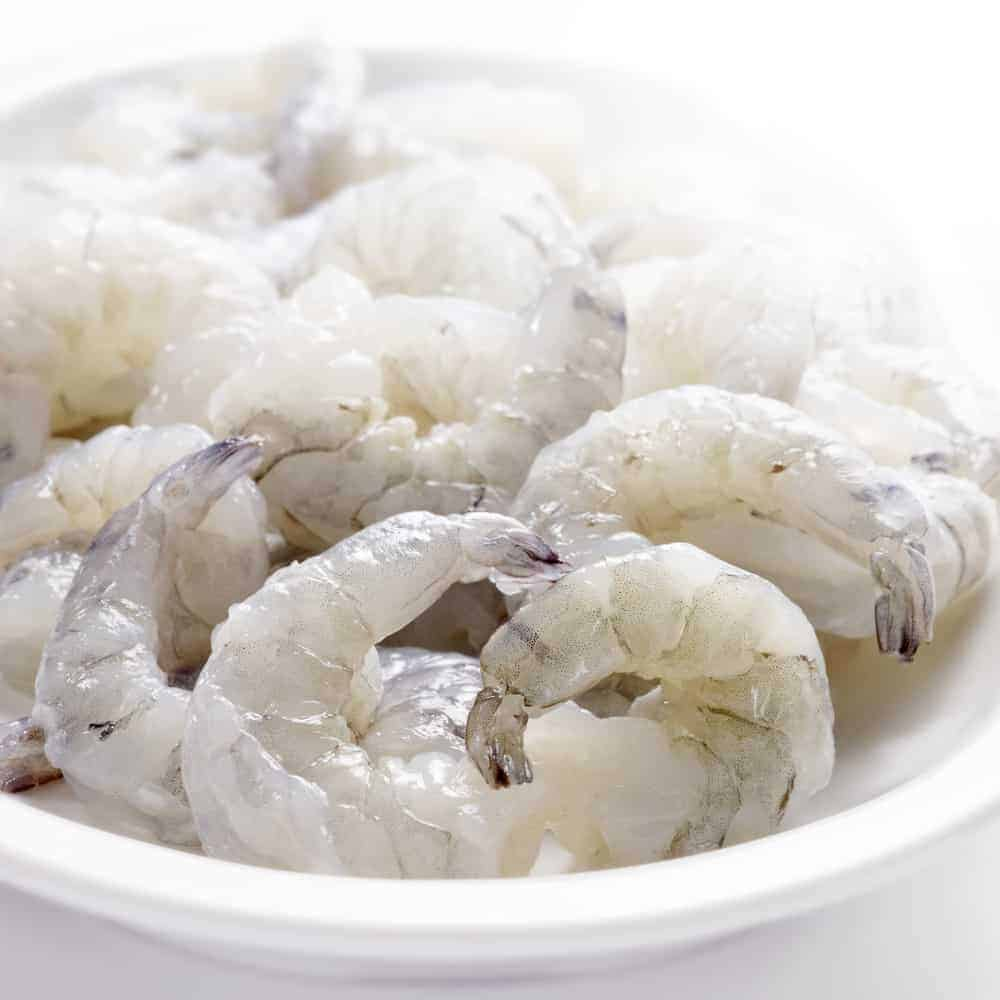 raw prawns in a white bowl without a marinate