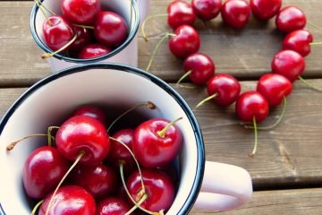 cherries in a mug and in the shape of a heart