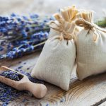 Bunch of lavender flowers and sachets filled with dried lavender.