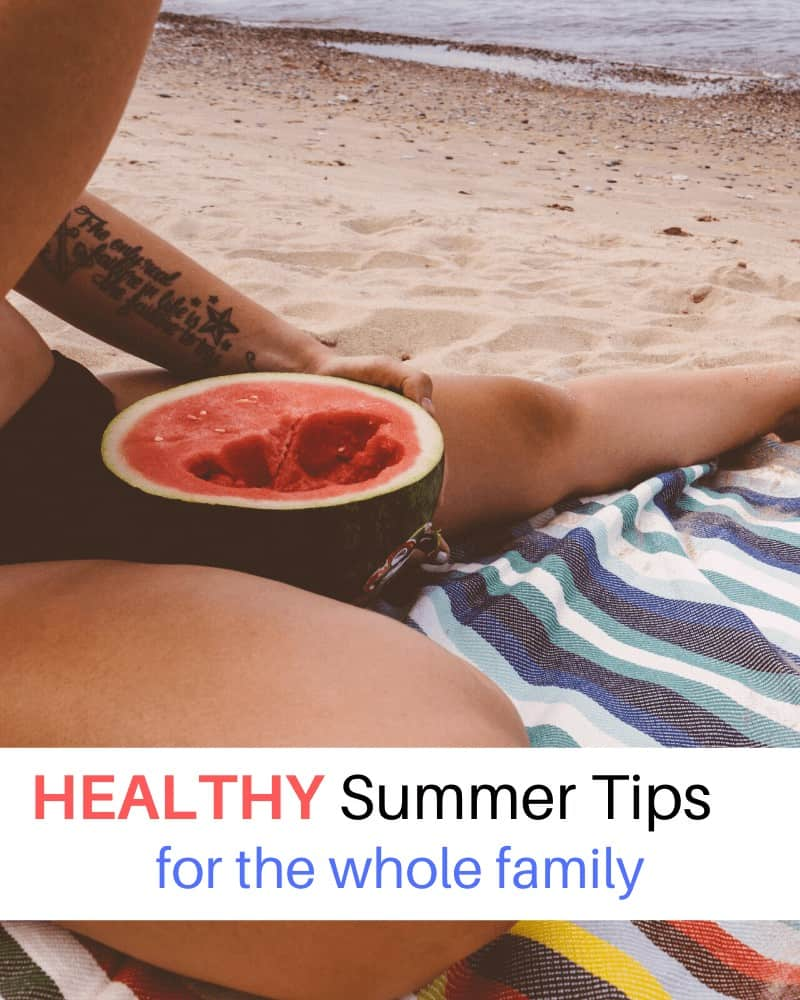 close up of woman eating watermelon on the beach with text overlay 'HEALTHY Summer Tips for the whole family'