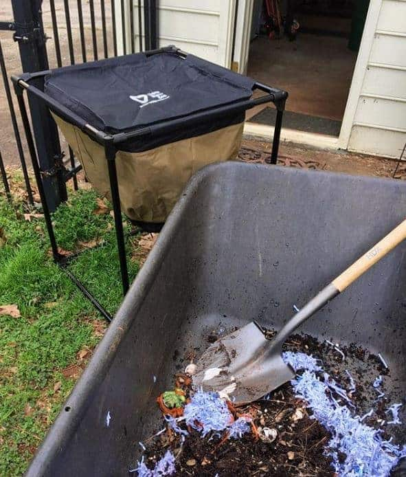 wheelbarrow full of compost and setting up a worm bin