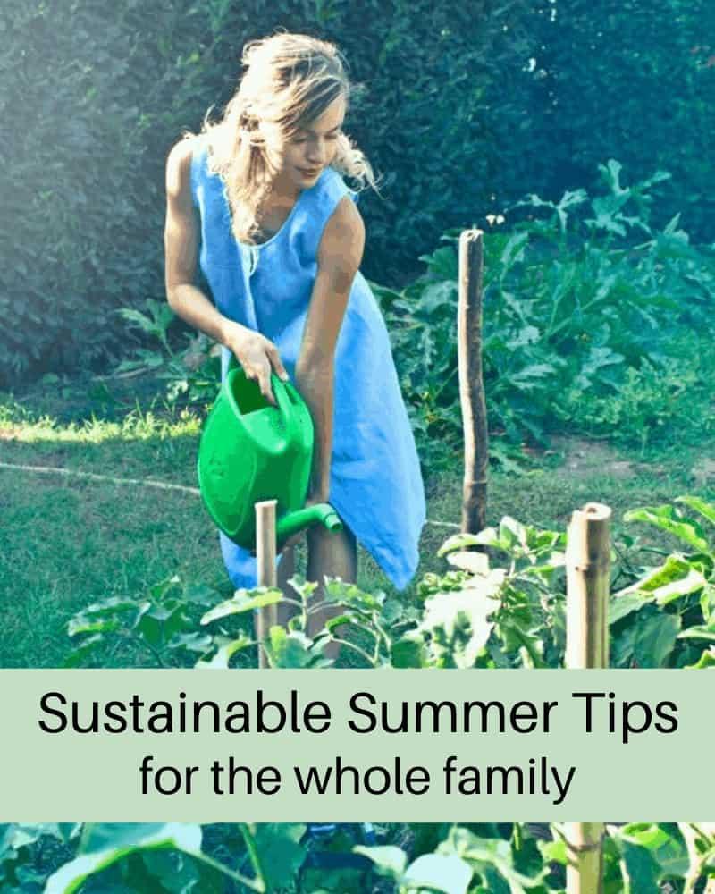 woman watering summer garden