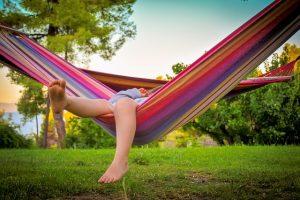 kid in hammok in summer