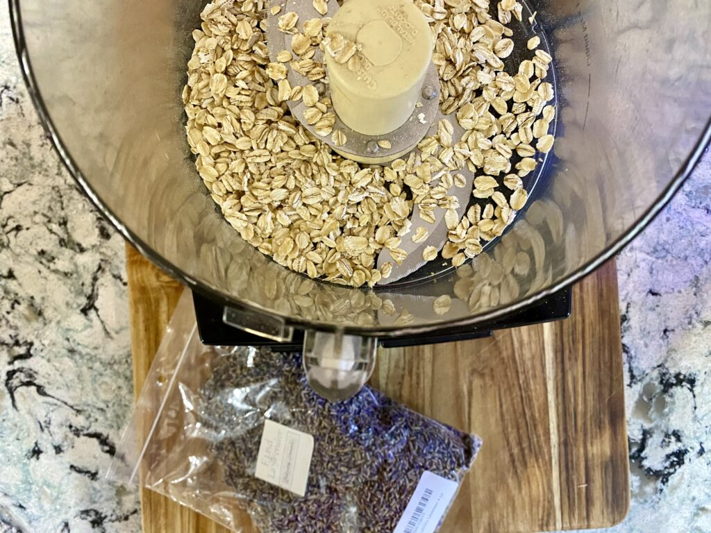 whole oats in food processor with bag of dried lavender near it