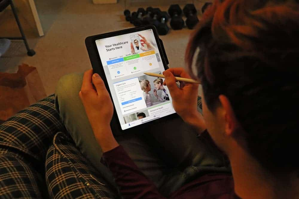 SIck college student using amwell app for healthcare