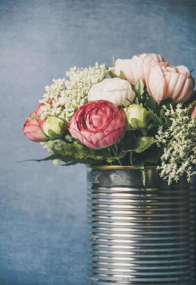 photo of flowers in a tin can vase