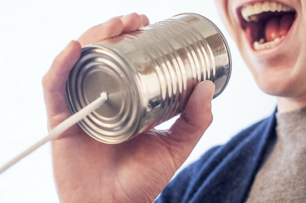adult using tin can phone