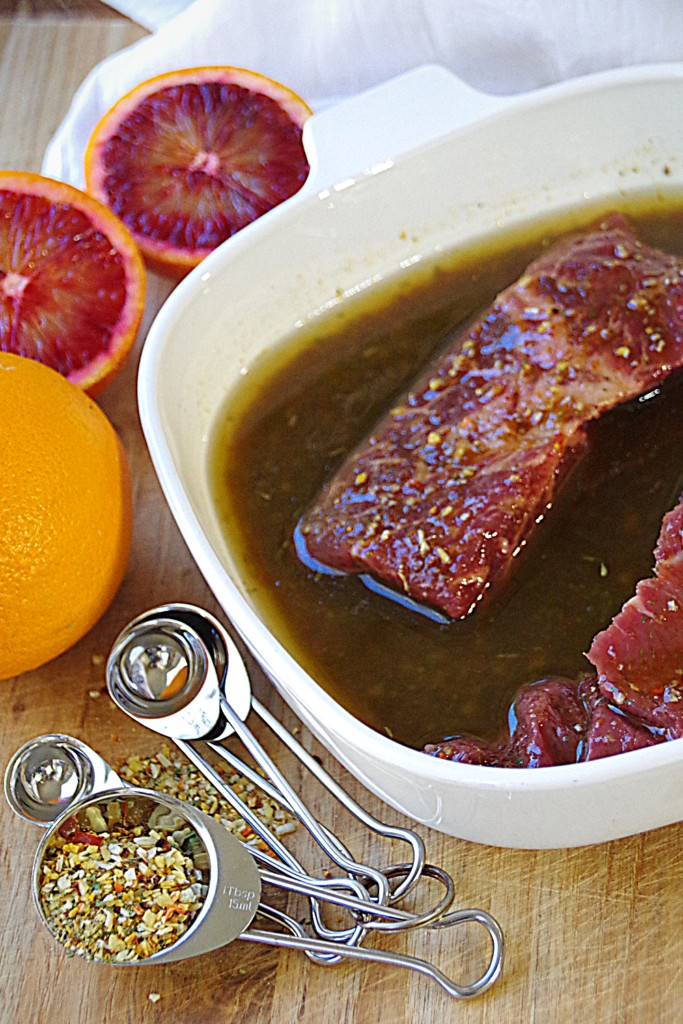 Steaks marinating in citrus herb vinaigrette