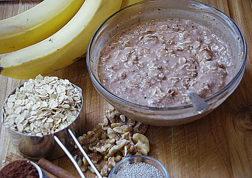 homemade oatmeal ingredients and chocolate overnight oats in bowl