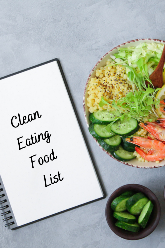 healthy food in a bowl next to a notebook that says clean eating food list