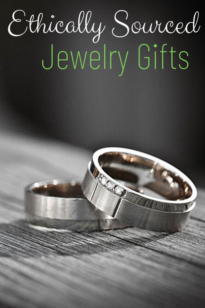 diamond and metal rings on wood board with text overlay 'Ethically Sourced Jewelry Gifts'