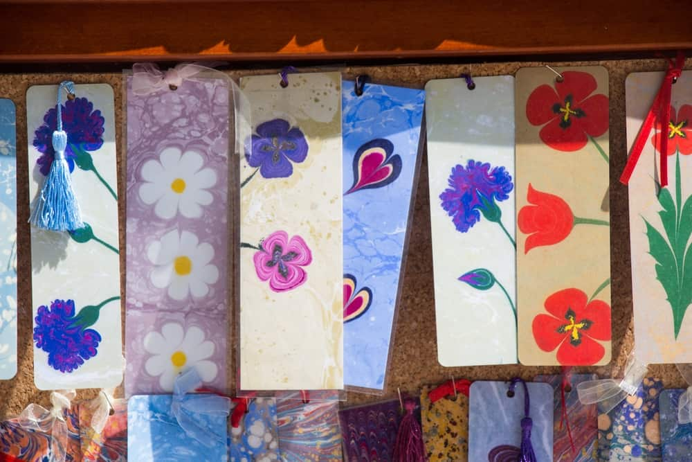 A closeup shot of colorful bookmarks with floral patterns made from old calendars
