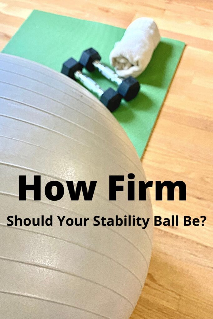 close up of exercise ball and workout equipment with text overlay 'How Firm Should Your Stability Ball Be?'