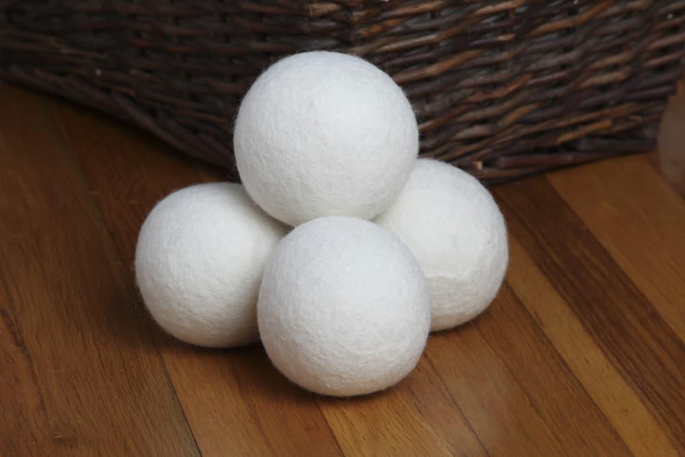 wool dryer ball on wooden floor