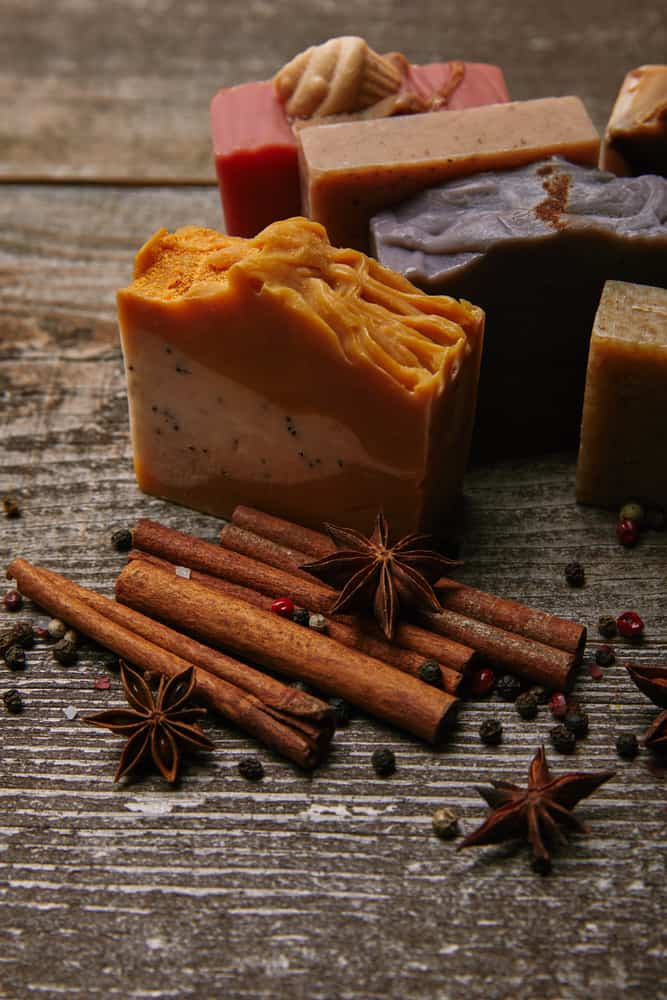 bars of homemade soaps with cinnamon and anise near it