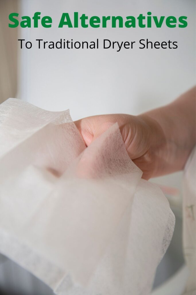 hand holding dryer sheets with text overlay 'safe alternatives to dryer sheets'