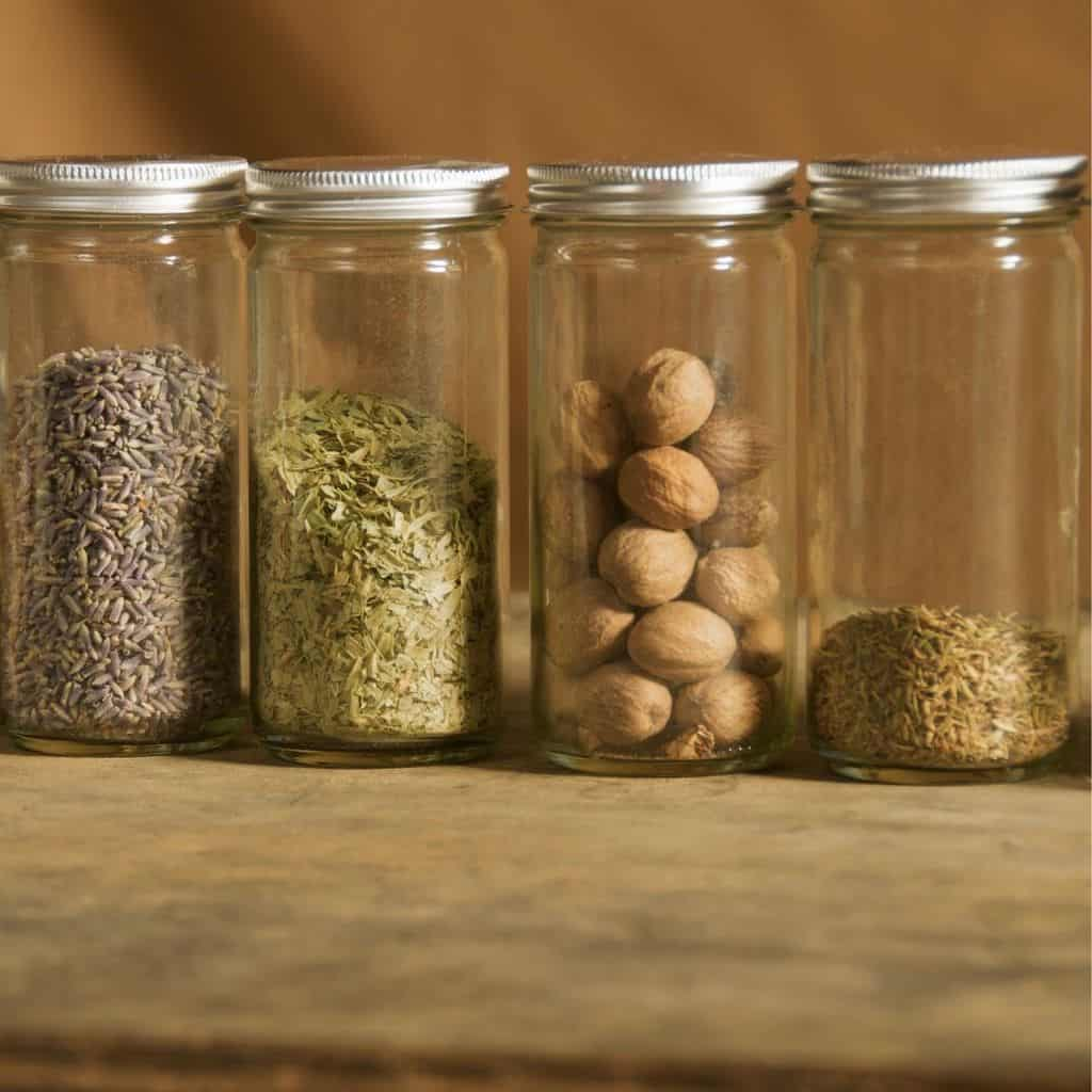 Jars of old spices on cutting board